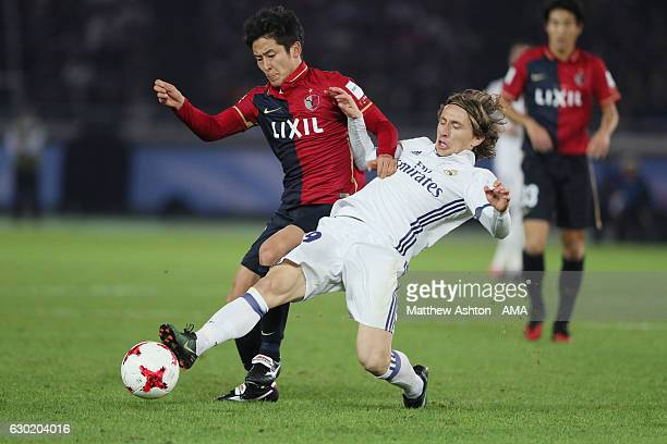 Shoma Doi of Kashima Antlers and Luka Modric of Real Madrid during the FIFA Club World Cup final match between Real Madrid and Kashima Antlers at...