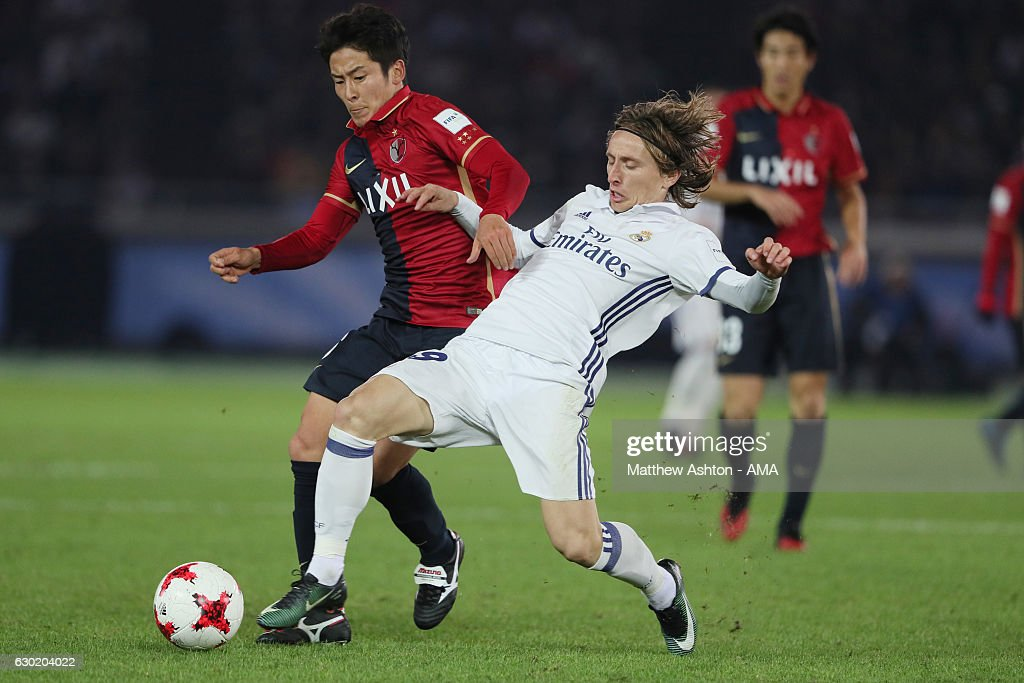 Shoma Doi of Kashima Antlers and Luka Modric of Real Madrid during the FIFA Club World Cup final match between Real Madrid and Kashima Antlers at International Stadium Yokohama on December 18, 2016 in Yokohama, Japan.