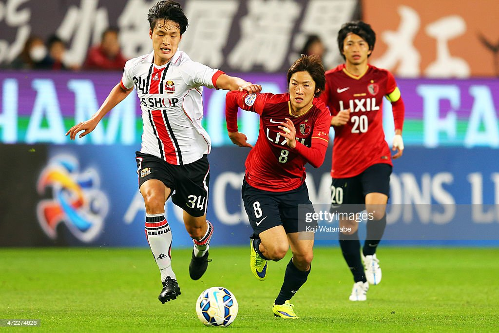 Shoma Doi #8 of Kashima Antlers and Park Yongwoo #34 of FC Seoul compete for the ball during the AFC Champions League Group H match between Kashima Antlers and FC Seoul at Kashima Stadium on May 5, 2015 in Kashima, Japan.
