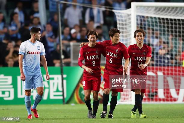Shoma Doi of Kashima Antlers celebrates with team mates after scoring a goal during the AFC Asian Champions League match between Sydney FC and...