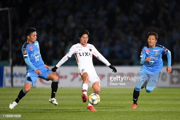 Shoma Doi of Kashima Antlers contols the ball under pressure of Ryota Oshima and Kazuaki Mawatari of Kawasaki Frontale during the JLeague J1 match...