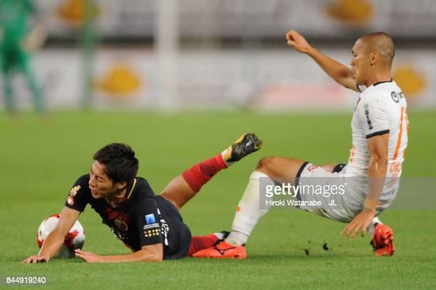 Shoma Doi of Kashima Antlers is challenged by Ryo Okui of Omiya Ardija during the J.League J1 match between Kashima Antlers and Omiya Ardija at...