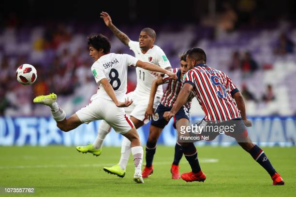 Shoma Doi of Kashima Antlers stretches to control the ball under pressure from Hedgardo Marin of CD Guadalajara during the FIFA Club World Cup UAE...