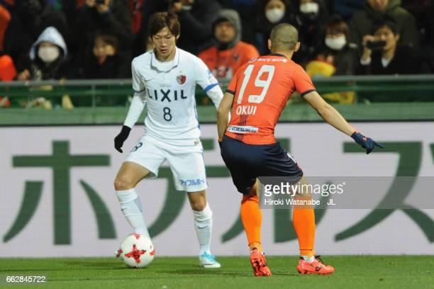 Shoma Doi of Kashima Antlers takes on Ryo Okui of Omiya Ardija during the J.League J1 match between Omiya Ardija and Kashima Antlers at Nack 5...