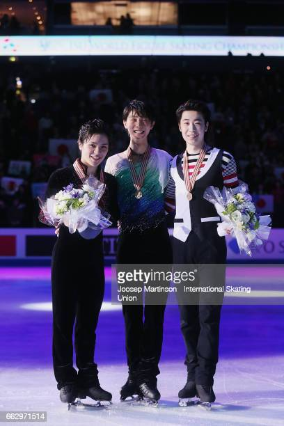 Shoma Uno and Yuzuru Hanyu of Japan and Boyang Jin of China pose in the Men's medal ceremony during day four of the World Figure Skating...