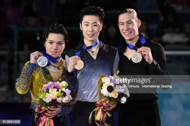 Shoma Uno of Japan Boyang Jin of China and Jason Brown of the USA pose with thier medals during day four of the Four Continents Figure Skating...