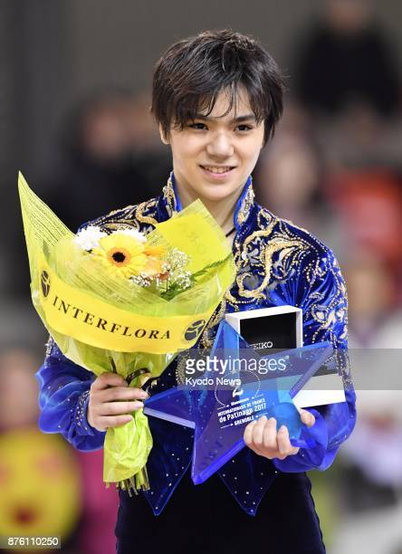 Shoma Uno of Japan celebrates after winning silver at the Internationaux de France the fifth round of the Grand Prix series in Grenoble France on Nov...