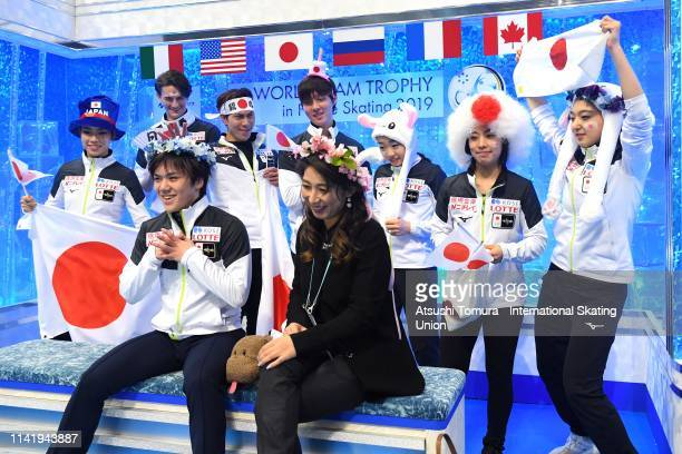 Shoma Uno of Japan celebrates his score with his team mates at the kiss and cry after competing in the Men's Single Short Program on day one of the...