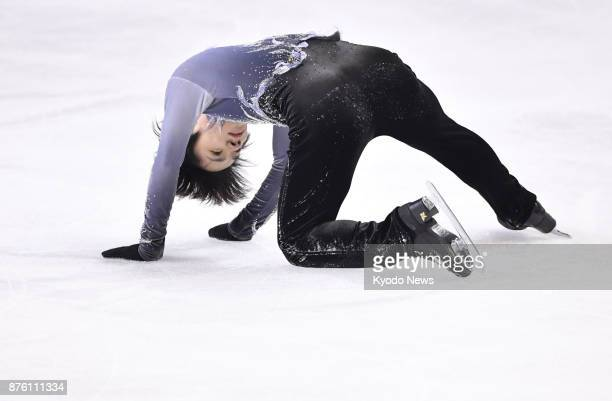 Shoma Uno of Japan falls during official practice ahead of the men's short program at the Internationaux de France the fifth round of the figure...