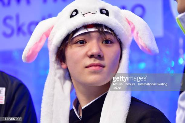 Shoma Uno of Japan is seen while RikaKihira of Japan waiting for her score with her team mates at the kiss and cry after competing in the Ladies...