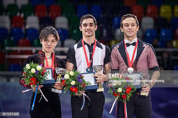 Shoma Uno of Japan Javier Fernandez of Spain and Alexei Bychenko of Israel pose during the Mens Singles Medal Ceremony on day three of the Rostelecom...