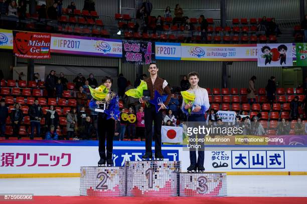 Shoma Uno of Japan Javier Fernandez of Spain and Misha Ge of Uzbekistan pose in the Men's medal ceremony during day two of the ISU Grand Prix of...