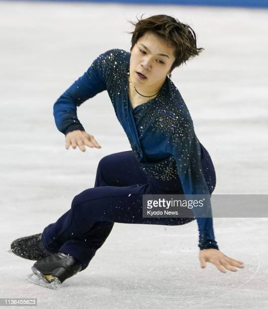 Shoma Uno of Japan lands awkwardly on a jump in the men's free skate at the World Team Trophy figure skating competition in Fukuoka southwestern...
