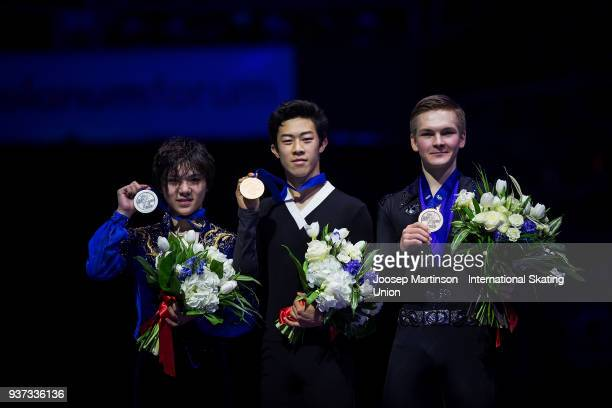 Shoma Uno of Japan Nathan Chen of the United States and Mikhail Kolyada of Russia pose in the Men's medal ceremony during day four of the World...