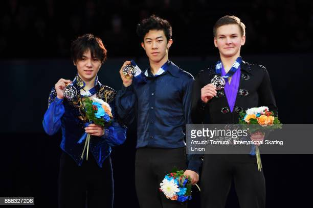 Shoma Uno of Japan Nathan Chen of the USA and Mikhail Kolyada of Russia pose on the podium after competing in the men free skating during the ISU...