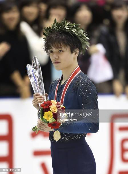 Shoma Uno of Japan poses with his gold medal after winning the NHK Trophy in Hiroshima Prefecture western Japan on Nov 10 2018 ==Kyodo