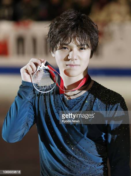 Shoma Uno of Japan poses with his silver medal after finishing in second at the Grand Prix Final in Vancouver Canada on Dec 7 2018 ==Kyodo