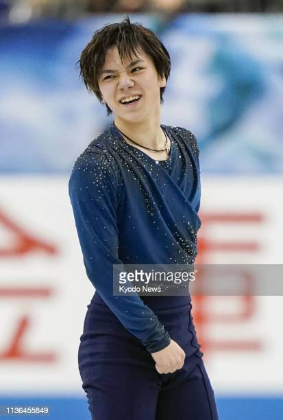 Shoma Uno of Japan reacts after his free skate at the World Team Trophy figure skating competition in Fukuoka southwestern Japan on April 12 2019...