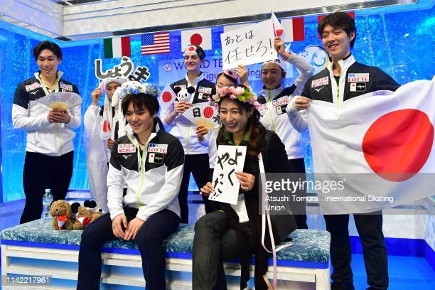 Shoma Uno of Japan waits for his score with his team mates after competing in the Men's Single Free Skating on day two of the ISU Team Trophy at...