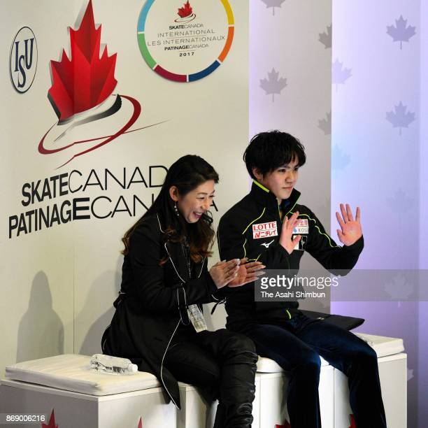 Shoma Uno of Japan waves to fans at the kiss cry with his coach Mihoko Higuchi after competing in the Men's Singles Free Skating during day two of...