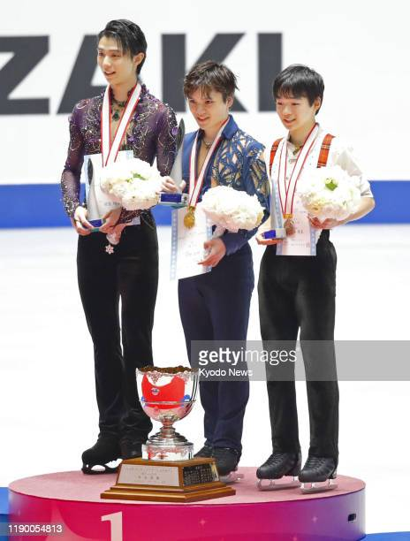 Shoma Uno poses after winning his fourth straight men's crown at Japan's national figure skating championships on Dec 22 at Yoyogi National Gymnasium...