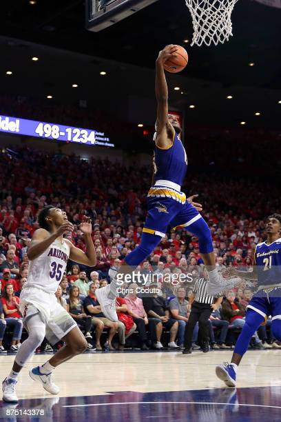 Shon Briggs of the Cal State Bakersfield Roadrunners grabs a pass intended for Allonzo Trier of the Arizona Wildcats during the second half of the...