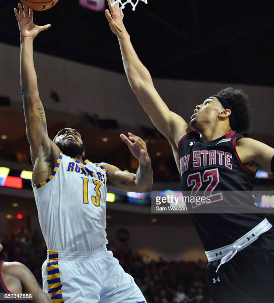 Shon Briggs of the Cal State Bakersfield Roadrunners shoots against Eli Chuha of the New Mexico State Aggies during the championship game of the...