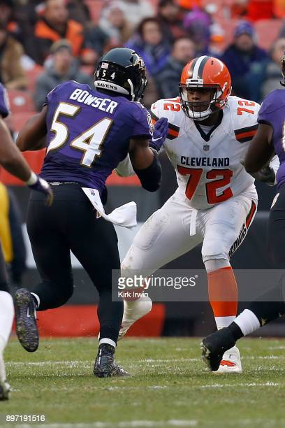 Shon Coleman of the Cleveland Browns defends against Tyus Bowser of the Baltimore Ravens during the game at FirstEnergy Stadium on December 17 2017...