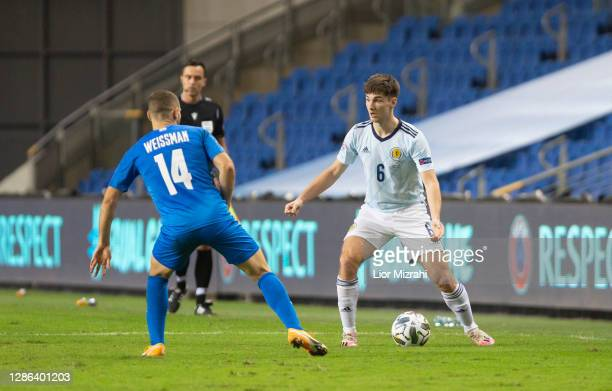 Shon Weissman of Israel challenges Kieran Tierney of Scotland during the UEFA Nations League group stage match between Israel and Scotland at Netanya...