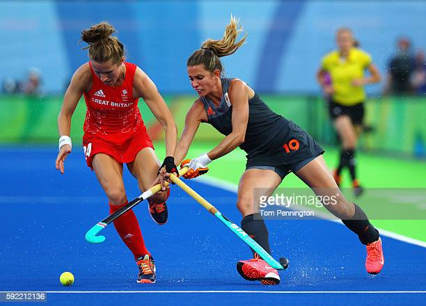Shona McCallin of Great Britain and Ellen Hoog of Netherlands action during the Women's Gold Medal Match against the Netherlands on Day 14 of the Rio...