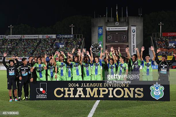 Shonan Bellmare players and staffs celebrate winning the J.League second division after the J.League second division match between Shonan Bellmare...