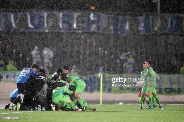 Shonan Bellmare players celebrates their first goal by Kaoru Takayama during the J.League match between Shonan Bellmare and Kawasaki Frontale at...