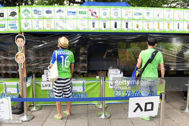Shonan Bellmare supporters visit a merchandise tent prior to the J.League Meiji Yasuda J1 match between Shonan Bellmare and Kashima Antlers at the...