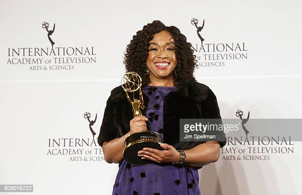 Shonda Rhimes pose with the 'Founders' award in the press room during the 44th International Emmy Awards at New York Hilton on November 21 2016 in...