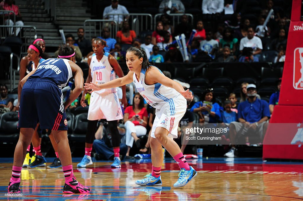 Shoni Schimmel #23 of the Atlanta Dream defends against Renee Montgomery #21 of the Connecticut Sun on July 29, 2014 at Philips Arena in Atlanta, Georgia.