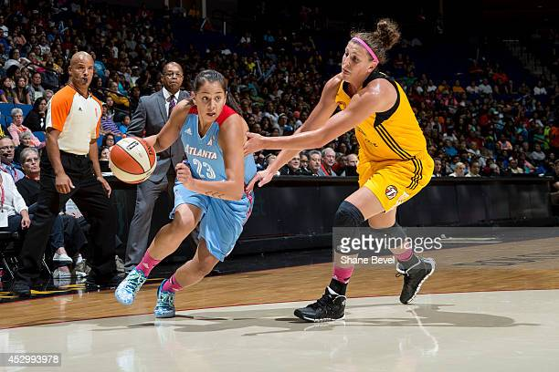 Shoni Schimmel of the Atlanta Dream drives against Jordan Hooper of the Tulsa Shock during the WNBA game on July 31 2014 at the BOK Center in Tulsa...