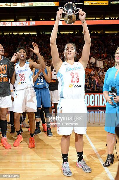Shoni Schimmel of the Eastern Conference AllStars hoists the MVP trophy after the 2014 Boost Mobile WNBA AllStar Game on July 19 2014 at US Airways...