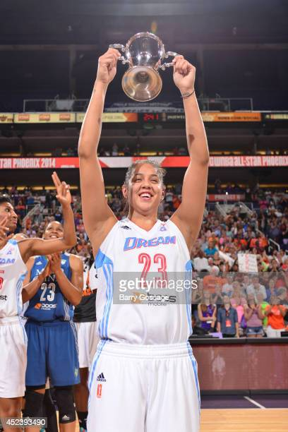 Shoni Schimmel of the Eastern Conference AllStars hoists the MVP trophy during the 2014 Boost Mobile WNBA AllStar Game on July 19 2014 at US Airways...