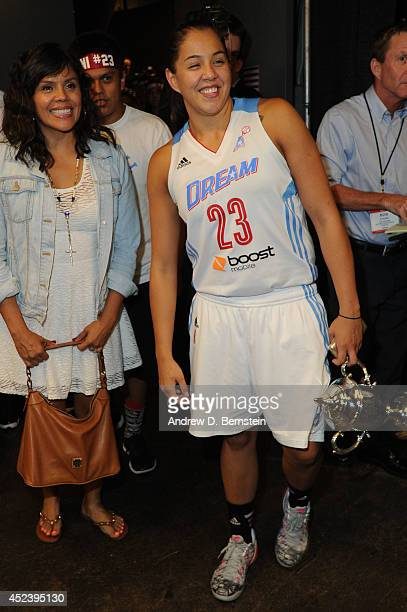 Shoni Schimmel of the Eastern Conference AllStars holds the MVP trophy after the 2014 Boost Mobile WNBA AllStar Game on July 19 2014 at US Airways...