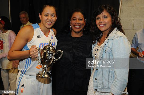 Shoni Schimmel of the Eastern Conference AllStars poses with WNBA President Laurel J Richie and her mother after being awarded the WNBA AllStar Game...