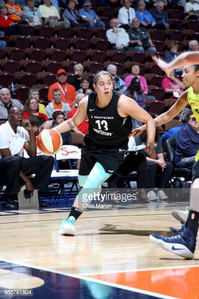 Shoni Schimmel of the New York Liberty handles the ball against the Dallas Wings during the preseason game on May 7 2018 at Mohegan Sun Arena in...
