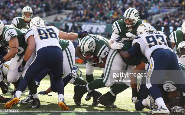 Shonn Greene of the New York Jets carries the ball into the endzone for a touchdown against the San Diego Chargers at MetLife Stadium on December 23,...