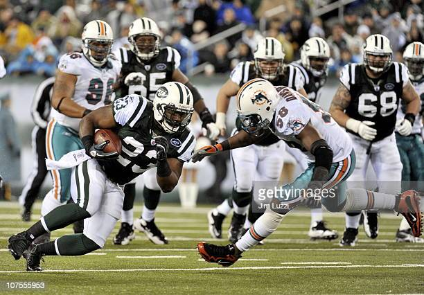 Shonn Greene of the New York Jets runs the ball against the Miami Dolphins at New Meadowlands Stadium on December 12, 2010 in East Rutherford, New...