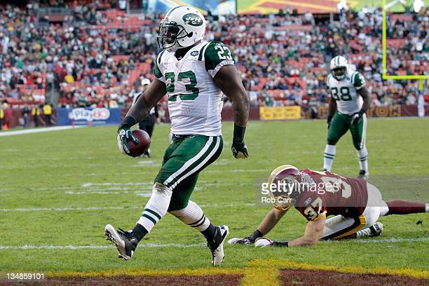 Shonn Greene of the New York Jets scores a touchdown in front of Reed Doughty of the Washington Redskins during the second half at FedExField on...