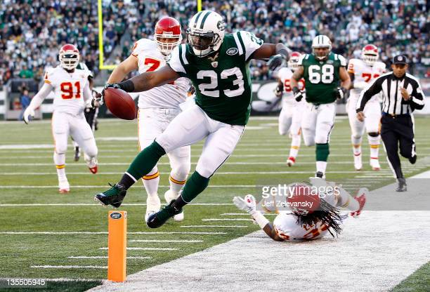 Shonn Greene of the New York Jets tries to stay in bounds on a run during a game against the Kansas City Chiefs at MetLife Stadium on December 11,...