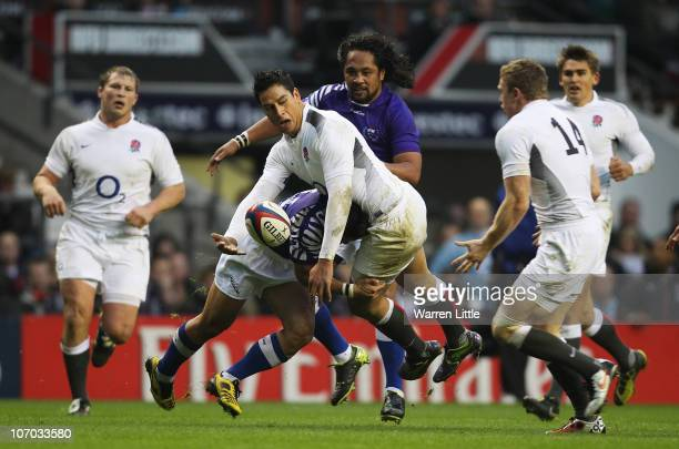 Shontayne Hape of England is tackled by David Lemi of Samoa during the Investec Challenge match between England and Samoa at Twickenham Stadium on...