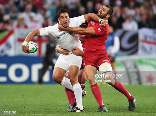 Shontayne Hape of England is tackled by Tedo Zibzibadze of Georgia during the IRB 2011 Rugby World Cup Pool B match between England and Georgia at...