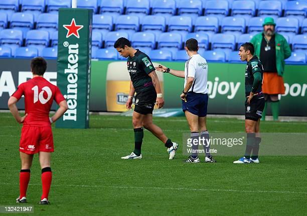 Shontayne Hape of London Irish is yellow carded by referee Romain Poite during the Heineken Cup match between London Irish and Edinburgh at Madejski...
