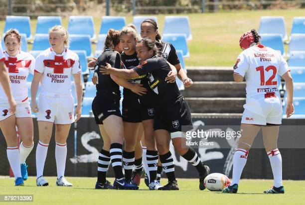Shontelle Woodman of New Zealand celebrates a try with team mates during the 2017 Rugby League World Cup Semi Final match between New Zealand and...