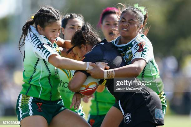 Shontelle Woodman of New Zealand is tackled during the 2017 Women's Rugby League World Cup match between New Zealand and Cook Islands at Southern...
